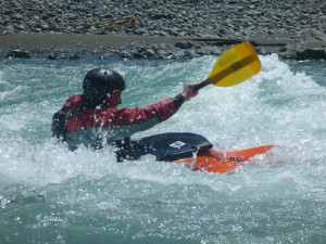 Playing at one of the larger rapids on the river
