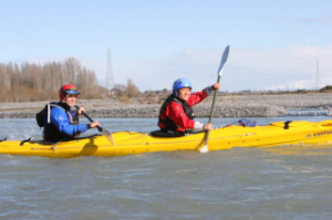 Lauri and me racing down the Waimak. Photo by PhotoChick