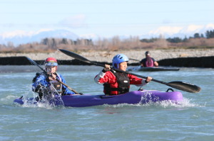 Lauri and me racing down the Waimak, Lauri providing the power, me the hot air. Photo by PhotoChick