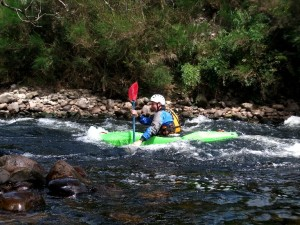 Playing on one of the smaller rapids